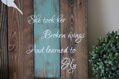 """Be inspired to chase your dreams! This reclaimed wood motivational quote sign has been hand crafted, hand painted and finished using the highest quality of materials so it can be enjoyed for years to come. From my paint brush to your home, I hope this sign is a beautiful reminder that no matter where you are, your wings will carry you forward. One Hand Crafted Reclaimed Wood Family Sign • Great gift for anniversaries,graduation, Christmas or a new job! • Quote reads, """"She took her broken…"""