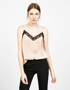 Sateen top with blonde lace neckline. Discover this and many more items in Bershka with new products every week