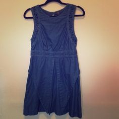 Denim dress with lattice detail Free people dress with lattice detailing on armholes and back. Small cutout on lower back, triangular panels on front. Never worn. Free People Dresses Mini
