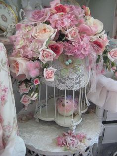 lovely boquet of pink roses, i just love the birdcage beneath with pink bird, and the tiny birdsnest with blue eggs ... so precious!