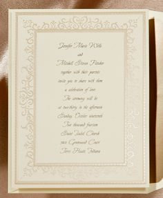 This lovely ecru invitation features an intricate border of fawn foil.