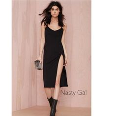 Black High Slit Slip Dress (S/M) Sexy black slip dress from Nasty Gal. High slit on left side. Thin shoulder straps. Sexy low cut neckline (best for smaller bust). Zipper and closure in back. Spandex. Size small but runs a bit big. Could probably fit a medium. I wear size xs/s and it fits relaxed as in the photos.  Dress measurements coming soon. Nasty Gal Dresses