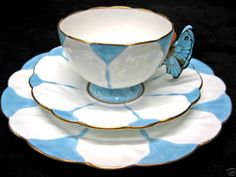 Butterfly theme tea cup. Great handle, although I'm not sure how easy it would be to drink from!