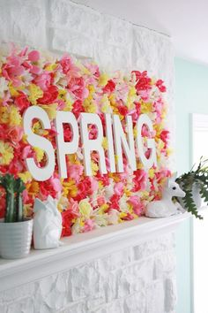 Glue fake flowers or scrunched tissue paper to board. Letters are mounted on foam blocks to raise them slightly. Party decoration or kids bedroom