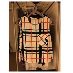 Zara grid pattern sleeveless top Orange and navy sleeveless top from Zara (size XS). Almost new condition. Zara Tops Tank Tops