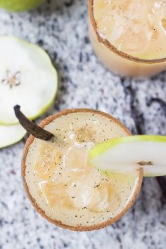 These Vanilla Pear Margaritas have all the best things a normal margarita would have, tequila and lemon (instead of lime) juice. Throw in a little pear juice, fresh vanilla bean, honey, and some cinnamon and I guarantee you'll be sipping this lovely drink all the way through winter!