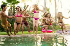 a group of girls in bikinis jump into a swimming pool in San Diego