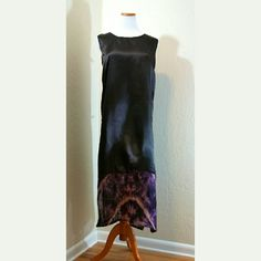 Unique Black Maxi w/ Tie Dye Burlap Hem Unique Black Maxi w/ Tie Dye Burlap Hem. No size or material tag. It's from the West African Country Cote D'Ivorie. That is all the info I can get with the attached tag. Silky feel black material. Purple tie Dye Burlap Hem w/ side splits. Possibly vintage. Definitely one of a kind. Excellent condition.  Bust 24 in (flat) Length 49 in  No Trade or PP  Offers Considered  Bundle discounts Dresses Maxi