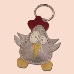 This cute little chicken keychain is completely made of 100% natural leather. Chicken is filled with cotton wool to get 3D look and soft touch. Dimensions of the chicken are 6 x 6 cm (2,36 x 2,36 in).
