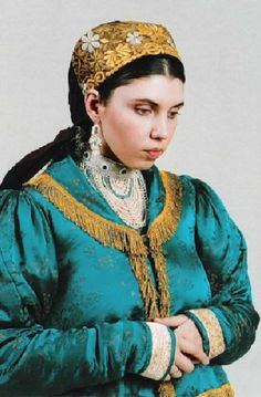 Russian traditional costume of a young married woman from Nizhny Novgorod Province. Modern work according to the fashion of the 19th century.