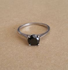 Here are my beautiful solitaire rings. This ring has a genuine black diamond set which measures 7mm wide (1.5ct). The black diamond is round brilliant cut and has VVS clarity - Absolutely stunning! The band measures 3mm as its widest point. This ring is available in either Titanium