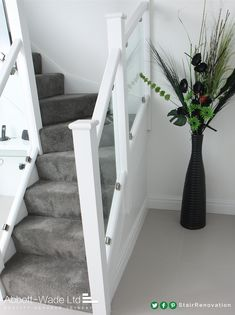 Dazzling white staircase with clamped glass