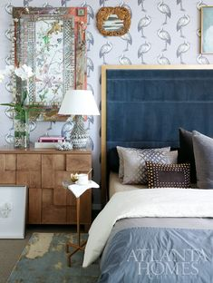 Bedroom by Michel Boyd. Featured in Atlanta Homes & Lifestyles. May 2012. Details:  Osborne & Little wallpaper. Wilson Cabinet and Ernie Drinks Table. Troy Bed. Marley Chandelier. All from Bradley Hughes. The mixed media piece is by the artist Nall. Rug is available through Verde Home.