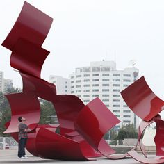 Paul Cocksedge - giant pages of poetry made from rolled steel sheets outside the China Millennium Monument