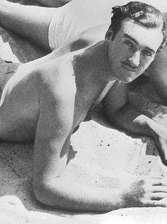 David Niven sunbathing at Santa Monica Beach on July 3rd, 1936