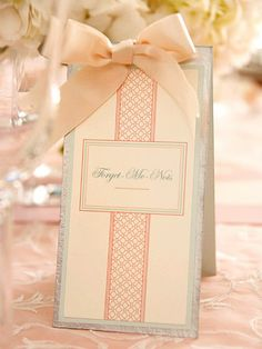 Diners Designation--Help guests find their seats by labeling each table with a name. The names for this wedding have significance because of the bride and groom's penchant for flowers and their desire to coordinate with the site's architecture.