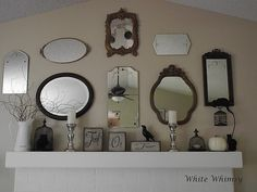 This isn't exactly how I want it to look, but I'm currently working on a mirror collage above my mantle.