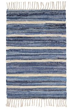Add some cool blue style to your cottage home with the Denim Rag Stripe Woven Cotton Rug. Handwoven from recycled denim jeans. Made in India.