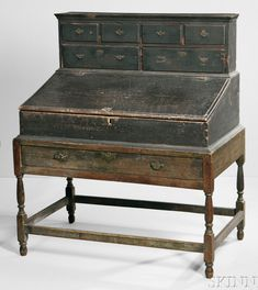 Skinner's 2961B 11/19/16 Lot: 30. Est: $3-5K. Sold: $4,613. Desc: Painted Pine & Maple Desk on Frame, prob. SE Mass., early 18th c. 3 sections, upper with flat molded cornice, 4 short thumb-molded drawers over 2 half drawers, the dovetailed desk with an interior of 8+2 compartments & 5 drawers, the lower with long drawer & straight skirt on block vase & ring-turned legs, turned feet & sqr. stretchers. Original brasses, wrought iron hinges & surface, 48 3/4 h., 39 1/2 w., 25 1/2 d.