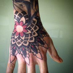 http://tattoos-ideas.net/mandala-hand-tattoo-by-marco-galdo/