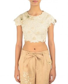 Ivory crop top with dori embroidered and French knot embroidered floral pattern. Round neckline and cap sleeves. Wash care: Dry clean onlyTrouser worn by the model is only for styling purpose