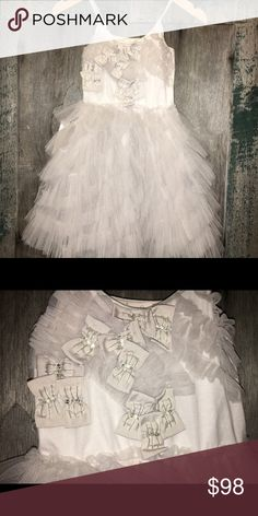 Tutu du Monde Treasure Trove Dress Beautiful shade of soft platinum has endless cascade of asymmetrical ruffles and sweet bows and sequins on the bodice.  Brand new. Tutu du Monde Dresses Formal