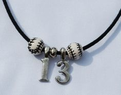 Baseballs & Numbers Necklace...Website has really cute sports jewelry for great prices...good girlfriend gifts too.
