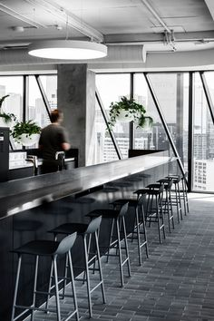 HASSELL completed the dynamic multi-floored offices of Transurban, a road operator company, located in Melbourne, Australia. Transurban's new urban Workplace Design, Corporate Design, Commercial Interior Design, Commercial Interiors, Tree Bed, Base Building, Office Bar, Urban Setting, Hanging Pots
