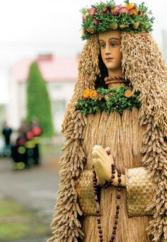 Poland: figure of the Divine Mother prepared for a harvest festival