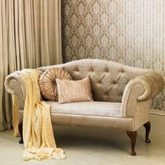 French-style. this is the kind of sofa i like - esp in white...
