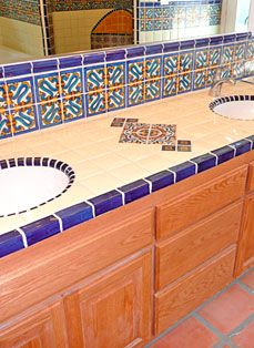 Light, mostly solid, tile on countertop.  Plain sink with tile rim.  Nice.