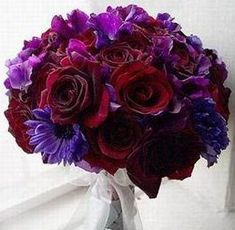 Bridal Bouquet: Black Magic Roses, Dark Purple Anemones, Purple Sweet Peas, Purple Lisianthus.