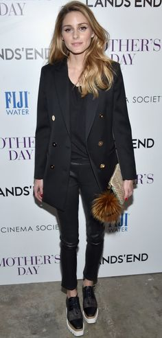 Olivia Palermo wore platform sneakers with her blazer and leather pants.
