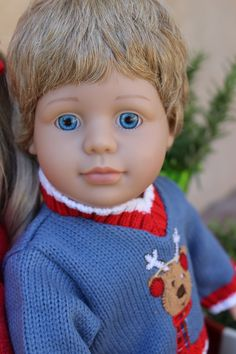 Our 18 inch boy Doll, Cameron, with blonde hair and blue eyes, daydreaming about Christmas. Available at www.harmonyclubdolls.com