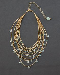 Unique designer multi-strand necklace featuring a cascade of natural blue topaz gemstone beads 11 strands of tiny gold finished brass beads are adorned with precious hand-faceted natural blue topaz gemstone briolettes. The topaz has been left untreated wh Seed Bead Necklace, Seed Bead Jewelry, Multi Strand Necklace, Boho Necklace, Gemstone Necklace, Pearl Jewelry, Boho Jewelry, Beaded Jewelry, Handmade Jewelry