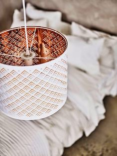 NYMÖ lamp shade, white powder-coated steel and a copper interior, $24.99 US - Designer: Lycke von Schantz. // Poppytalk: More New from IKEA for February