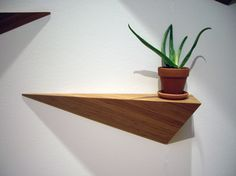 "angle shelf (why have a boring straight shelf??)  6.5""w x 26.5""d x 8.25""h  bamboo & tung oil"