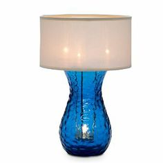 The pairing of deep sea blue and clean white lends a chic crispness to interiors. Glass lamp with flame-retardant polyester shade uses four ...