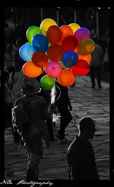 Love how everything is Black and White except for the balloons. A POP of color!