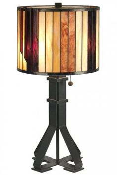 Tiffany Table lamp crafted from resin and hand-rolled art glass. 2-light. Finish: dark antique bronze.