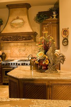 Mullet Cabinet Tuscan Inspired Kitchen Featuring An