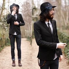 long hair, top hat, skinny jeans, cigarette, cuffed jeans, scruffy.