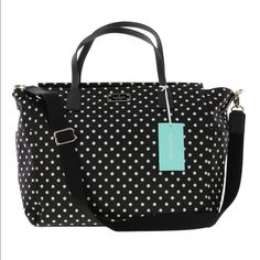 Kate Spade Diaper Bag NWT Authentic Kate Spade Blake Avenue Diamond Polka Dots Taden Baby Diaper Bag. Lots of room on the inside. Cute and stylish and perfect for baby.   Original: $300  nylon Black saffiano leather handles Black nylon shoulder strap 14-karat light gold plated hardware  Zipper closure  Two exterior slide pockets Interior features: Changing pad Changing pad holder Fully lined, easy-to-wipe nylon interior  Interior zip pocket  Two interior slide pockets kate spade Bags Baby…