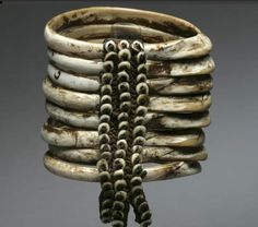 New Guinea ~ Papua New Guinea | Bracelet made from stacked boar's tusks, fiber and nassa shells | 660$