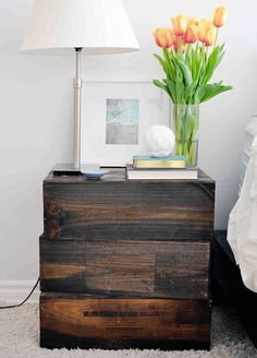 This simple nightstand is made of three stained wooden wine boxes that have been overturned. Such a smart way to repurpose!