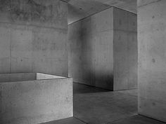 Interior Design Addict: Via thehardt Located in Paspels, Switzerland, School in Paspels (1998) by Valerio Olgiati. The structure is a reinforced concrete monolith. The architect did not use right angles for the outside, so although at first glance the exterior geometry seems simple, closer study reveals a chain-like reaction of slight distortions that shroud the building in an air of strangeness. Inside, however each classroom on the first and second floors has two right-angled sides that…