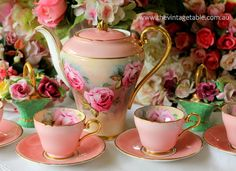 pink teapot, cups and saucers