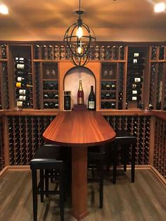 Custom Wine Storage & Table - Wine storage can include more than just space for wine. Add tables, stemware racks, arches and display nooks. Wine Cellar Basement, Wine Cellar Racks, Wood Wine Racks, Wine Rack Wall, Wine Rack Design, Wine Cellar Design, Custom Home Builders, Custom Homes, Wine Display