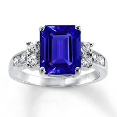 An emerald-cut lab-created blue sapphire is the star of this sterling silver ring. Added sparkle comes from round lab-created white sapphires flanking the main sapphire. Ruby Jewelry, Fine Jewelry, Gold Jewellery, Craft Jewelry, Diamond Jewelry, Silver Jewelry, Rings For Her, Engagement Jewelry, Ruby Engagement Rings