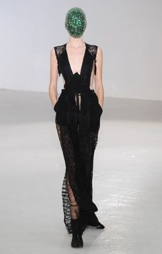 MAISON MARTIN MARGIELA  More than just a daring black dress, this Maison Martin Margiela will satisfy the customer who loves a dose of edge with her serving of haute couture.